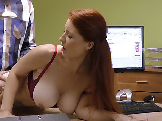 Attractive boobs of credit manager. Redhead
